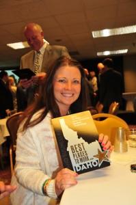 Leah O'Flynn holding the award